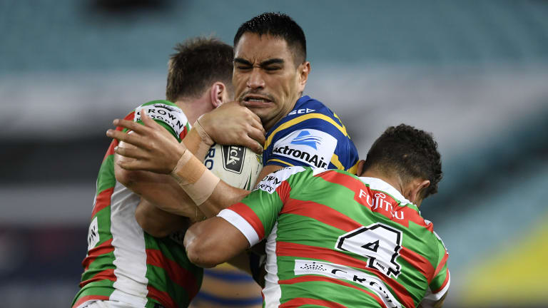 Big hit: Parramatta's Marata Niukore charges into the South Sydney defence.