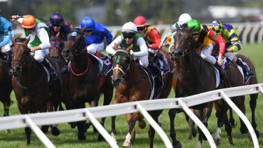 Sigrid Carr rides The Inevitable (centre, white cap, white sleeves) to victory in the CS Hayes Stakes.