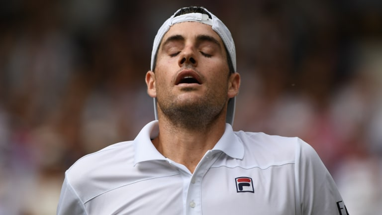 Exhaustion: John Isner during the semi-final marathon.