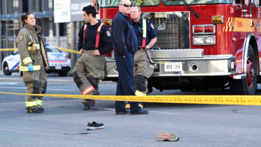Shoes lay on the street as first responders secure the area in Toronto after a van mounted a sidewalk crashing into a crowd of pedestrians on Monday.