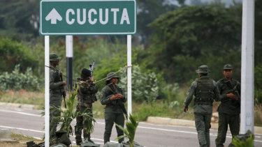 Venezuelan soldiers gather on the Venezuelan border near the Colombian city of Cucuta.