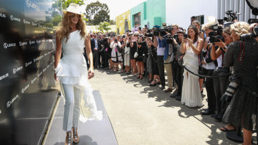 The Body in the Birdcage: Elle Macpherson arrives at Derby Day.