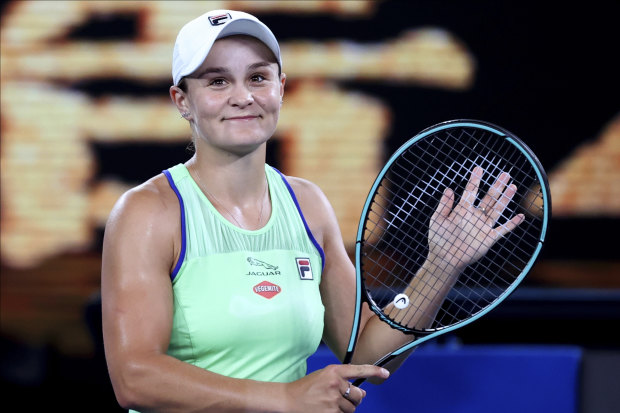 Ash Barty is all smiles after beating Lesia Tsurenko of Ukraine in their first round match on Monday night.