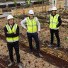 Jack Davis,Peri Mcdonald and Stephen Choi in the rooftop farm at the Burwood Brickworks shopping centre.