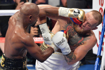Pay day: Floyd Mayweather Jnr gets in the face of Conor McGregor. Mayweather won in a 10th-round stoppage in Las Vegas.