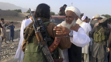 Taliban fighters gather with residents to celebrate a three-day cease fire marking the Islamic holiday of Eid al-Fitr, in Nangarhar province, east of Kabul, Afghanistan, in June.