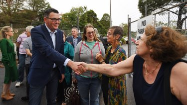 Victorian Premier Daniel Andrews is greeted by locals after announcing plans to expand parking facilities at Belgrave train station.