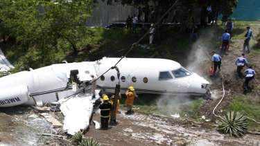 Emergency crew working at the wreckage site where  private jet crashed.