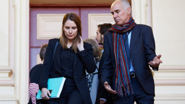 Hannah Quinn's lawyer Lauren MacDougall with Ms Quinn's father outside court on Tuesday.