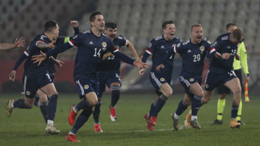 Scotland celebrate their penalty shootout victory over Serbia at the Rajko Mitic stadium in Belgrade which earned them qualification for the Euros, after a 23-year absence from major men's tournaments.