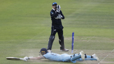 Ben Stokes dives in to make his ground, accidentally knocking the ball to the boundary  with his bat for four overthrows, to make it six runs off the ball.