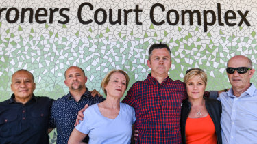 The parents of young people who died at music festivals embrace outside the NSW Coroners Court.