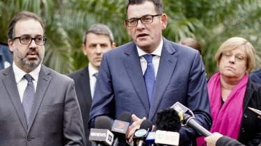 Victorian Premier Daniel Andrews (centre) with Attorney General Martin Pakula and Police Minister Lisa Neville.