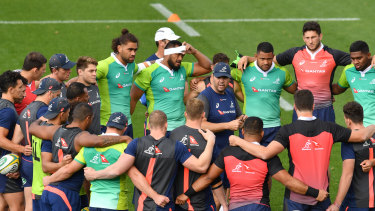 Outside chances: The Wallabies get tight during training at Ballymore.