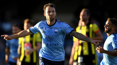 Calm and collected: Adam Le Fondre celebrates after converting from the spot at Campbelltown Sports Stadium.