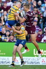 Tom Trbojevic flies high to snatch the ball from Clint Gutherson for a brilliant Manly try.