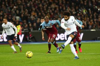 Mohamed Salah scores from the penalty spot against West Ham.