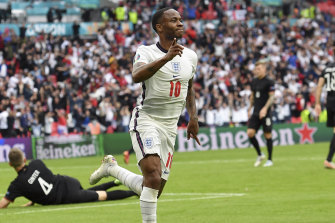 Sterling celebrates after scoring in England's game against Germany.