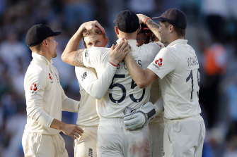 England celebrate the wicket of Matthew Wade.