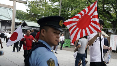 The rising sun flag is displayed at Tokyo's Yasukuni Shrine, which is dedicated to the memory of Japan's war dead.