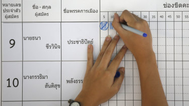 An election officer counts votes at a polling station in Bangkok, Thailand.