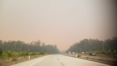 A near-deserted Pacific Highway near Port Macquarie as it was closing this afternoon.