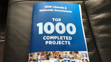 "The Liberals have created a booklet with their ""top 100 completed projects"", which was handed to journalists on the campaign bus."