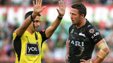 Referee Matt Cecchin sends Sam Burgess to the sin bin.