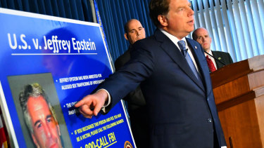 Geoffrey Berman, US attorney for the Southern District of New York, details the new charges, while standing next to a poster displaying the image of fund manager Jeffrey Epstein last week.