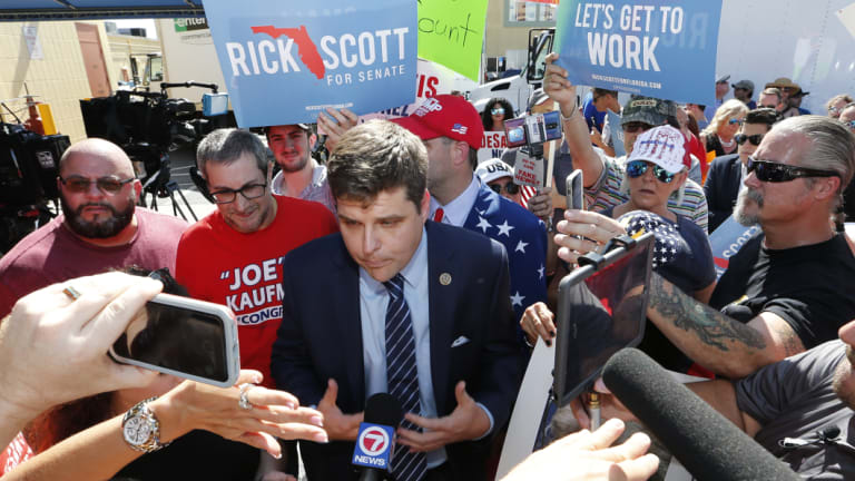 US Representative Matt Gates speaks with the media during a protest at the Broward County Supervisor of Elections office on Friday.