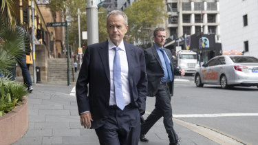 Labor leader Bill Shorten walks in to a Sydney apartment tower for lunch with billionaire Anthony Pratt.