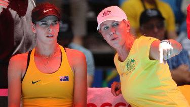 In the spotlight: Australia's captain Alicia Molik talks with Ajla Tomljanovic.
