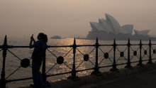 Smoke haze covers Sydney Harbour as temperatures are set to soar.