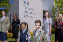 Jenny Williams, principal at Firbank Grammar, and  Kit Willow, designer of the school's new uniforms, with students Eloise Bolton, Max Gordon,  Kennedy Gordon, and Grace Gordon.