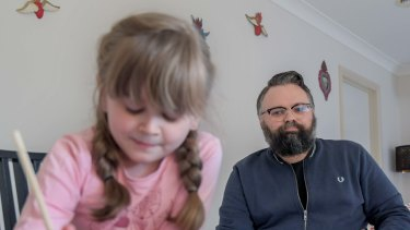 Disability worker David Wragg, at home with his daughter Elissa, has serious misgivings about the quality of her remote education.