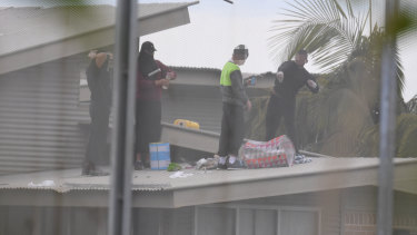 Inmates are seen on the roof of Frank Baxter Juvenile Justice Centre during a riot at Kariong, NSW.