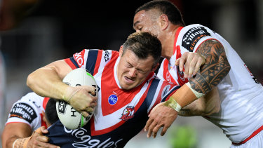 Brett Morris helps the Roosters to a 34-12 win against the Dragons at Jubilee Oval on Saturday night.