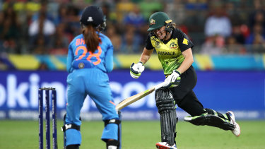 Alyssa Healy scrambles between wickets in the loss to India.