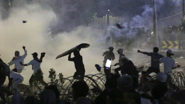 Rocks, riot shields and tear gas: central Jakarta on Wednesday night.