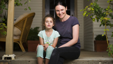 Evie Clark and her mother Samara Zeitsch at their home a week after Evie was stung up to 300 times when she fell into a wasp nest.