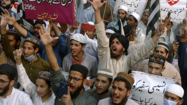 People chant during a protest in Pakistan against French President Emmanuel Macron and the republishing of caricatures of the Prophet Muhammad.