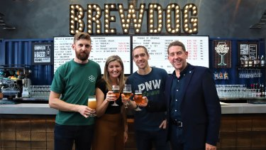 (From left) Matt McIvor from Range Brewing, Skills Minister Shannon Fentiman, Martin Dickie from BrewDog and State Development Minister Cameron Dick toast the course at a new beer laboratory at Coopers Plains.