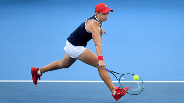 Ash Barty reaches for a backhand during the doubles final of the Brisbane International.