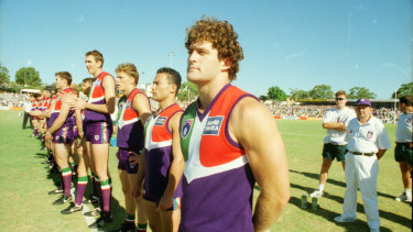 The Dockers line up for the first match against an AFL team, a practice match against Essendon.