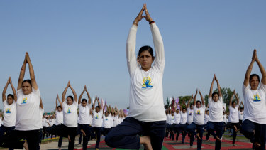 Indian paramilitary soldiers perform yoga on International Yoga Day at a base camp in Humhama, India-controlled Kashmir.