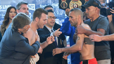 Strange scenes: Horn and Mundine are separated at the weigh-in.