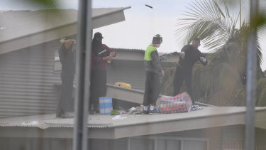 Inmates are seen on the roof of Frank Baxter Juvenile Justice Centre at Kariong  during the riot.