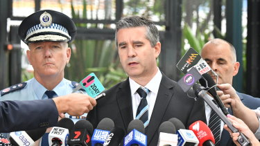 NSW Police Assistant Commissioner Scott Cook (centre) with Commissioner Mick Fuller (left) in 2018.