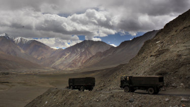 Indian army trucks drive near Pangong Tso lake near the India-China border in India's Ladakh area in 2017.