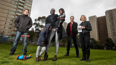 (From left) Atherton Gardens residents Ranko Cosic and Jenny Nyibol and her children, with City of Yarra councillor Stephen Jolly and residents association member Margaret O'Brien.